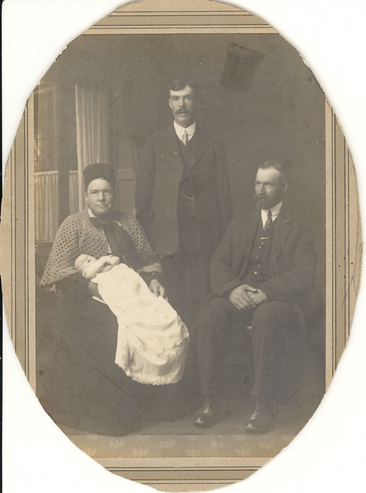 Harriet as baby with father and gparents